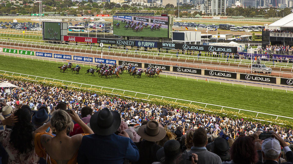 Racing fans, pictured here in attendance at the Melbourne Cup in 2019.