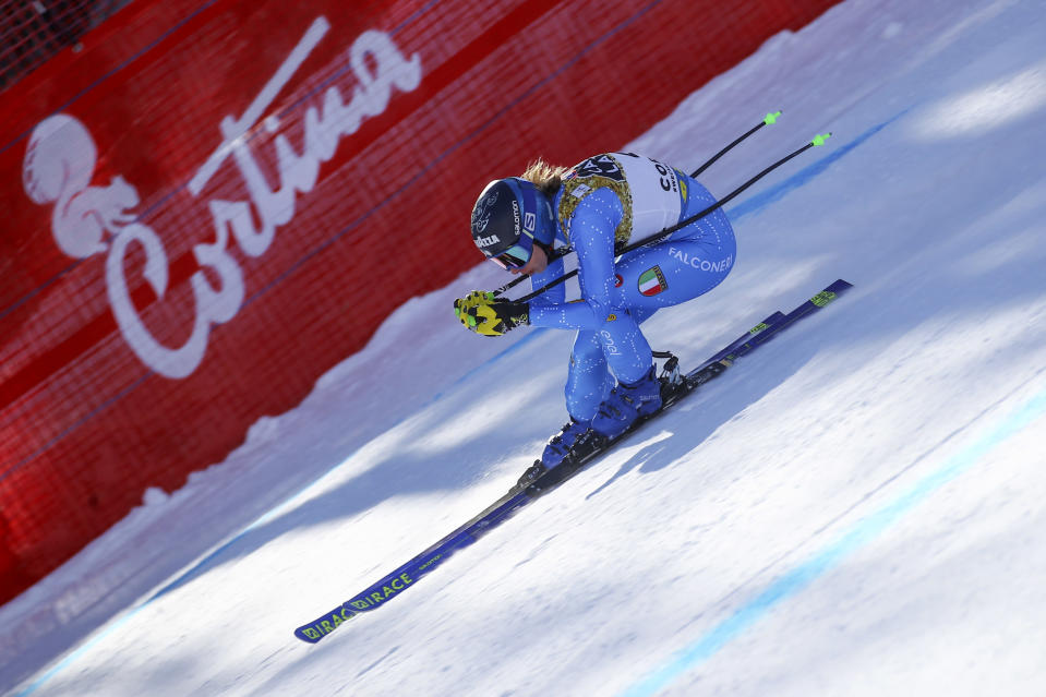 Italy's Francesca Marsaglia speeds down the course during a women's downhill training, at the alpine ski World Championships, in Cortina d'Ampezzo, Italy, Friday, Feb. 12, 2021. (AP Photo/Marco Trovati)
