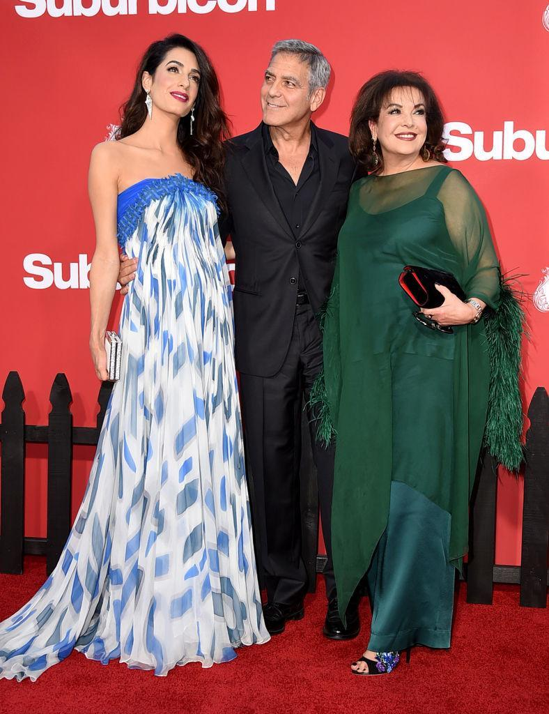 <p><strong>When: Oct. 22, 2017</strong><br>Amal Clooney brought a special guest: Her equally stylish mother, Baria Alamuddin! While Amal kept it simple in a strapless blue and white print maxi dress, Baria dazzled in a floor-length deep green kaftan dress and an elegant chin-length bob. (<em>Photo: Getty)</em> </p>