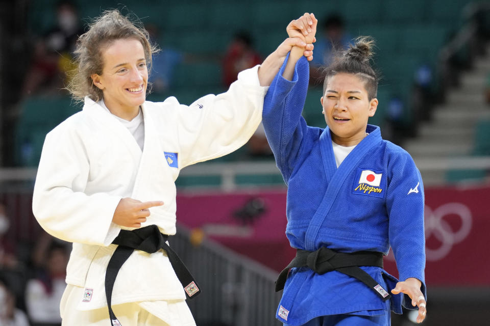 Distria Krasniqi of Kosovo, left, and Funa Tonaki of Japan react after competing in their women's -48kg championship judo match at the 2020 Summer Olympics, Saturday, July 24, 2021, in Tokyo, Japan. (AP Photo/Vincent Thian)