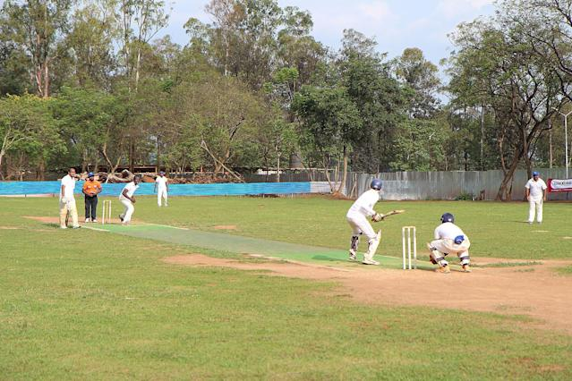 Cricketers during a game on September 7, 2014 at ETO Kicukiro, the former technical school of Kigali where thousands of Rwandans were killed during the 1994 genocide (AFP Photo/Stephanie Aglietti)