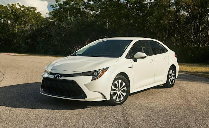 """<p>For the first time, Toyota is offering <a href=""""https://www.caranddriver.com/toyota/corolla"""" rel=""""nofollow noopener"""" target=""""_blank"""" data-ylk=""""slk:the Corolla"""" class=""""link rapid-noclick-resp"""">the Corolla</a> with a hybrid powertrain. Following the latest gas-powered Corolla to market, the Corolla hybrid serves up a stellar 52 mpg on the EPA's combined cycle. Unlike the mechanically similar Prius, the Corolla looks utterly normal—or as normal as the regular Corolla sedan, which itself stands out, thanks to its huge grille opening and thin headlights. The driving experience is similarly down to earth, with a comfortable, quiet ride and a nicely hushed engine (unlike <a href=""""https://www.caranddriver.com/news/a26522505/toyota-corolla-hybrid-vs-honda-insight/"""" rel=""""nofollow noopener"""" target=""""_blank"""" data-ylk=""""slk:the Corolla's direct competitor, the Honda Insight"""" class=""""link rapid-noclick-resp"""">the Corolla's direct competitor, the Honda Insight</a>, which is growly under hard acceleration). </p>"""