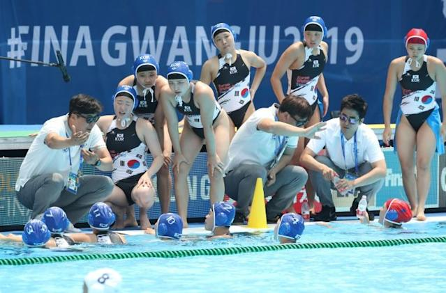 South Korean players listen to their coach during their 64-0 water polo drubbing by Hungary at the 2019 World Championships in Gwangju (AFP Photo/Handout)