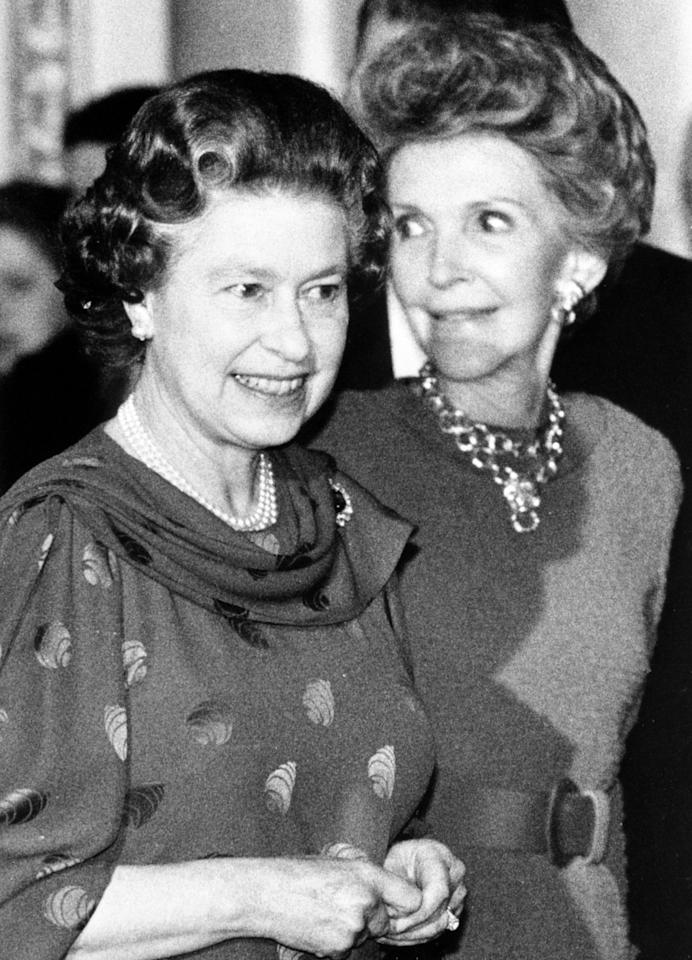 <p>The Queen welcomes the American First Lady Nancy Reagan to Buckingham Palace, where President Reagan and his wife had tea. (PA Archive) </p>