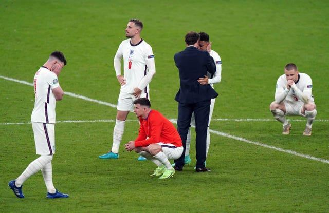 England manager Gareth Southgate consoles his players after the defeat