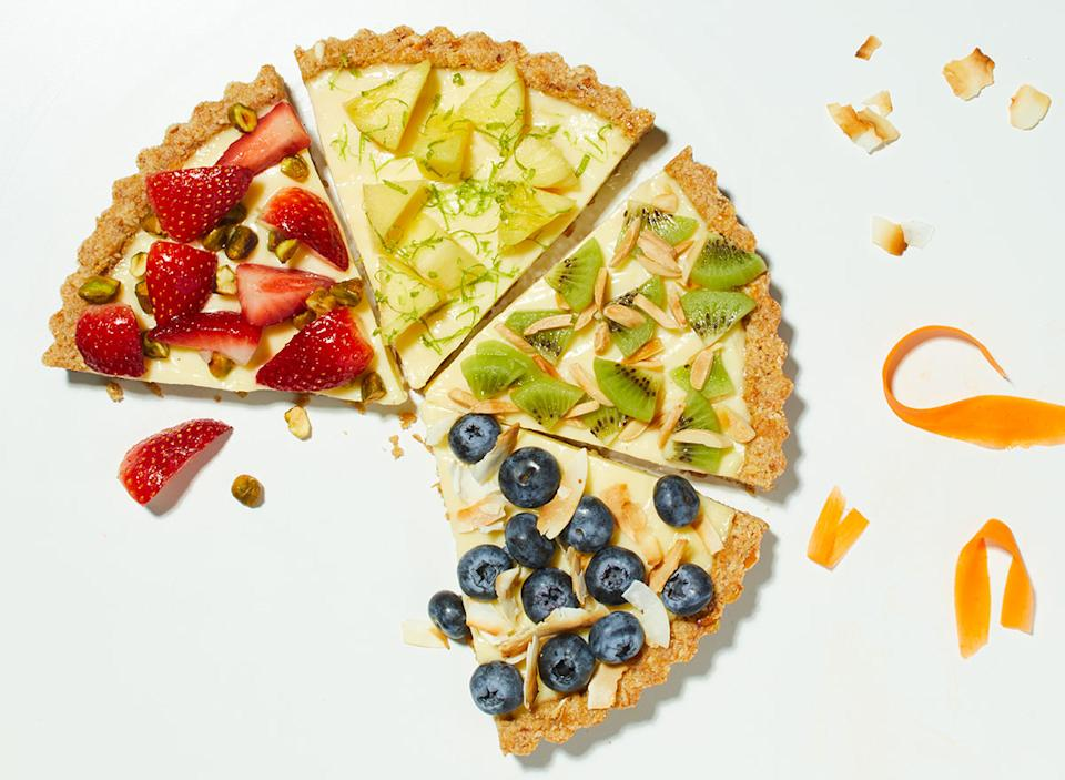 spring fruit and cream tart slices with strawberries, pineapple, kiwi, and blueberries