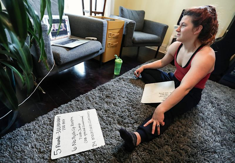 Anna Rode, coaching and programming director for Naptown Fitness, prepares to lead a bodyweight workout from her Indianapolis home via Zoom software on Thursday, April 23, 2020.