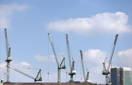 FILE PHOTO: Cranes line the London skyline on construction sites in London, Britain August 17, 2016. REUTERS/Neil Hall