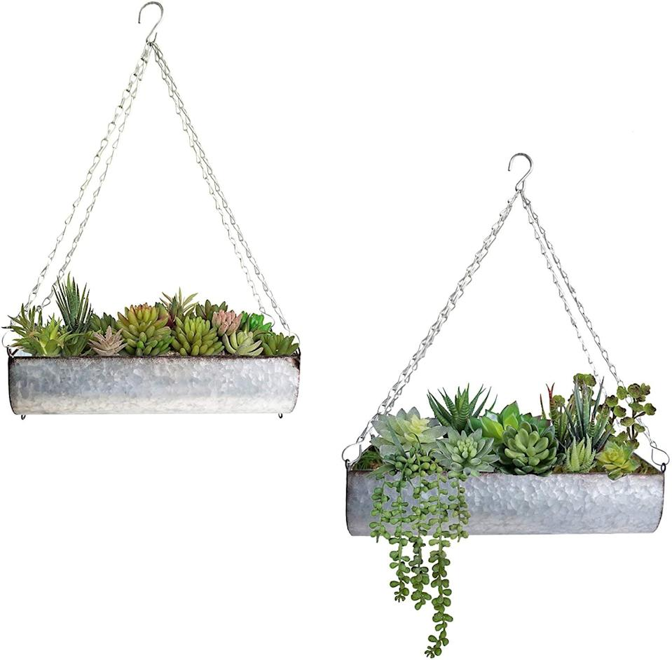 <p>If you have more of an industrial aesthetic, go for the <span>ShabbyDecor Galvanized Metal Hanging Trough Flower Planter, Set of 2</span> ($27).</p>