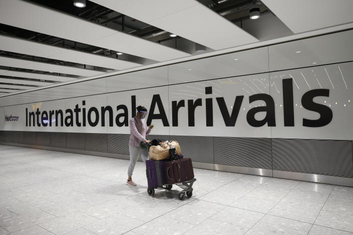 LONDON, ENGLAND - JANUARY 30: Travelers arrive at Heathrow Terminal 5 on January 30, 2021 in London, England. The UK government has added flights from the UAE to the