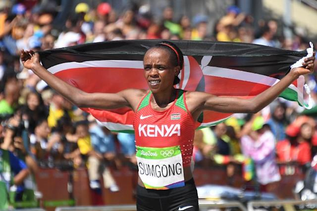 Kenya's Jemima Sumgong celebrates her victory in the women's Olympic marathon in Rio on August 14, 2016 (AFP Photo/Johannes Eisele)
