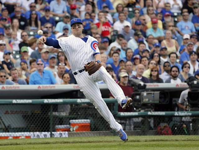 Chicago Cubs third baseman Mike Olt throws out Pittsburgh Pirates' Russell Martin after fielding Martin's sacrifice bunt during the second inning of a baseball game on Friday, June 20, 2014, in Chicago. (AP Photo/Charles Rex Arbogast)