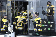 Fans watch Boston Bruins defensemen Zdeno Chara (33), John Moore (27) and teammates leave the ice after they were defeated by the Columbus Blue Jackets in overtime at an NHL hockey game, Thursday, Jan. 2, 2020, in Boston. (AP Photo/Elise Amendola)