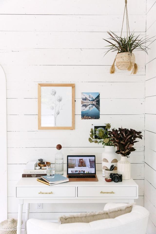 """<p>If your office is making you feel overwhelmed, check out your desk. If it's cluttered or, well, just plain sad, it likely isn't a great place to work. Instead, follow Camille Styles's lead.</p> <p>""""I like to keep the surface of my desk clean and organized with a few inspiring touches,"""" she says. """"A cup full of good black pens makes me feel ready to take on the day, and I've always got a notebook or two for jotting down inspiration, a great scented candle with matches, my headphones for when I need to work without interruption, and a <a href=""""http://goto.target.com/c/249354/81938/2092?subId1=RS%2C5TipsforCreatingaCalmerWorkspace%252CFromDesignProCamilleStyles%2Ckholdefehr1271%2CDEC%2CIMA%2C689303%2C202001%2CI&u=https%3A%2F%2Fwww.target.com%2Fp%2F17oz-glass-ypsilon-carafe-with-cork-top-bormioli-rocco%2F-%2FA-52242250%3F"""" target=""""_blank"""">big carafe</a> of filtered water that I fill up every morning to refill my glass and stay super hydrated throughout the day."""" </p> <p>Even if you only have a cubicle, you can still incorporate a carafe of water into your daily work routine—who knows, it may end up making your desk feel a little more like a spa. </p>"""
