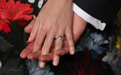 Princess Eugenie's padparadscha sapphire and diamond engagement ring - Credit: Jonathan Brady/PA Wire