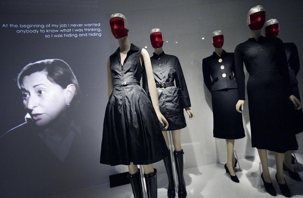"""Miuccia Prada, left, speaks in a video about her two fashions, center, and those of Elsa Schiaparelli, right, at an exhibit at the Metropolitan Museum of Art, Monday, May 7, 2012 in New York. The show """"Schiaparelli and Prada, Impossible Conversations,"""" opens May 10 and continues through Aug. 19. (AP Photo/Mark Lennihan)"""
