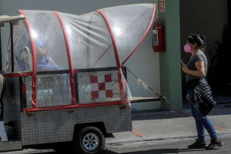 Paramedics move a patient suspected of having Covid-19 at a hospital in Mexico City, on December 30, 2020