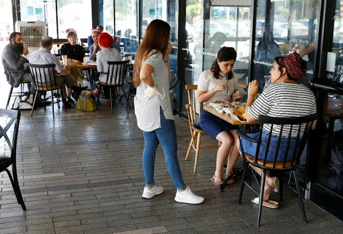 Residents of the West Bank settlement of Ariel going about errands or sipping drinks at cafés were hardly focused on whether Prime Minister Benjamin Netanyahu would seek to expand Israeli sovereignty to the community (AFP Photo/JACK GUEZ)