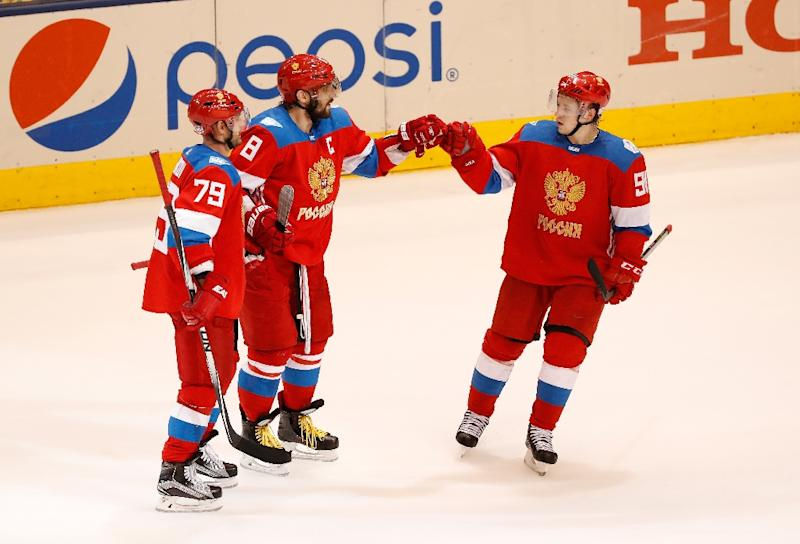 Alex Ovechkin  8 of Team Russia celebrates his third-period goal with  Andrei Markov 7438c211a
