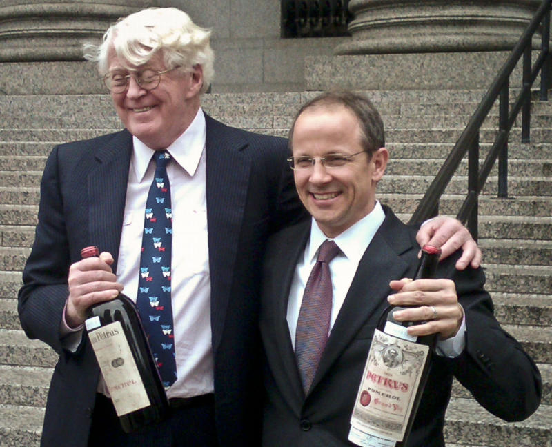 Florida billionaire William Koch, left, and his lawyer John Hueston hold bottles of wine outside Manhattan federal court, Friday, April 12, 2013, in New York. A Manhattan jury concluded the wines were sold to Koch fraudulently at a 2005 auction by a California businessman.  The jury awarded him $12 million Friday in punitive damages a day after awarding him $380,000 in compensatory damages. Koch said it's the best he's felt since winning the America's Cup in 1992.  (AP Photo/Larry Neumeister)