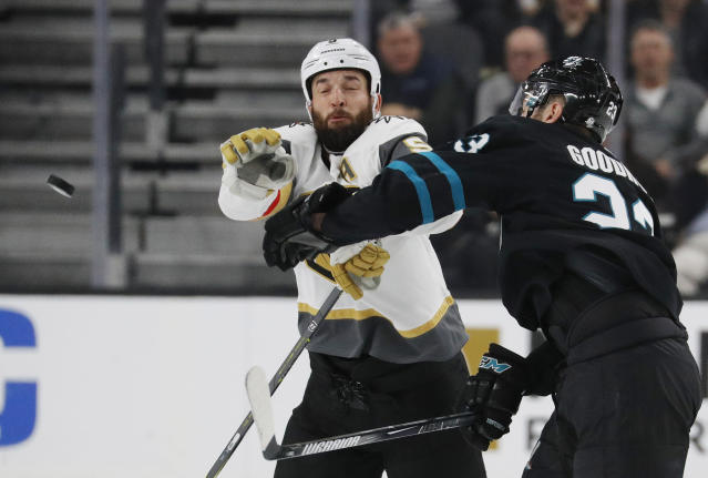 San Jose Sharks right wing Barclay Goodrow, right, and Vegas Golden Knights defenseman Deryk Engelland try to knock the puck out of the air during the second period of an NHL hockey game Thursday, Jan. 10, 2019, in Las Vegas. (AP Photo/John Locher)