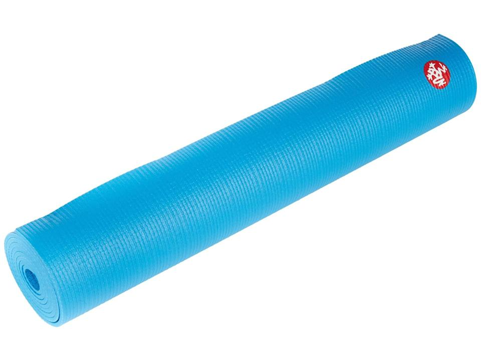 """<h3>Manduka PROlite™ Yoga Mat</h3> <br>""""At home, I have a Manduka Prolite mat,"""" Roberts says. """"[It's] not too heavy and has tons of cushion.""""<br><br><strong>Manduka</strong> PROlite™ Yoga Mat, $, available at <a href=""""https://go.skimresources.com/?id=30283X879131&url=https%3A%2F%2Fwww.zappos.com%2Fp%2Fmanduka-prolite-yoga-mat-dresden-blue%2Fproduct%2F7690994%2Fcolor%2F155935"""" rel=""""nofollow noopener"""" target=""""_blank"""" data-ylk=""""slk:Zappos"""" class=""""link rapid-noclick-resp"""">Zappos</a><br>"""