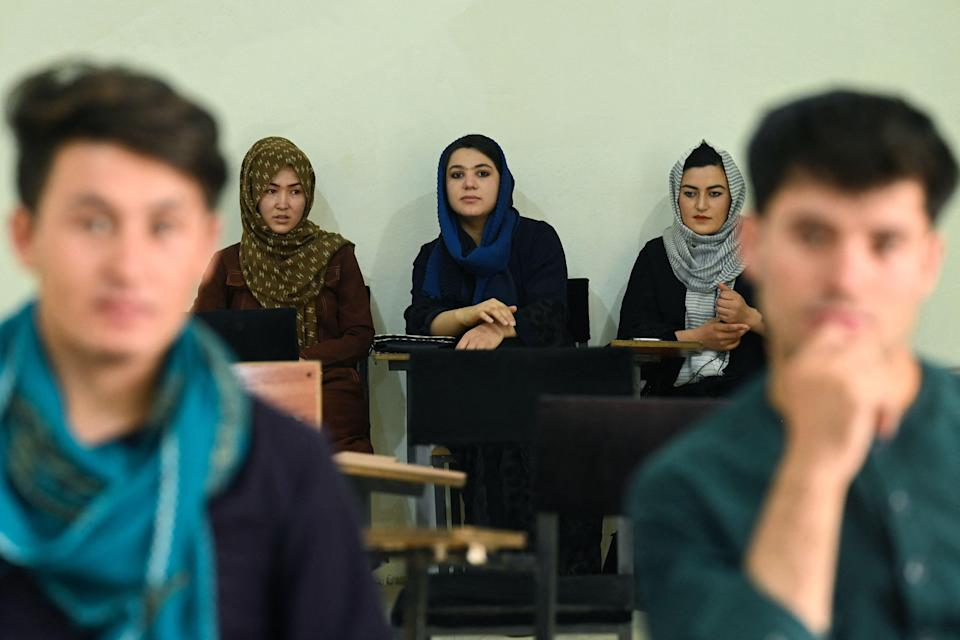 attend their class after private universities were reopened in Kabul on September 6, 2021. Women attending private Afghan universities must wear an abaya robe and niqab covering most of the face, the Taliban have ordered, and classes must be segregated by sex -- or at least divided by a curtain.