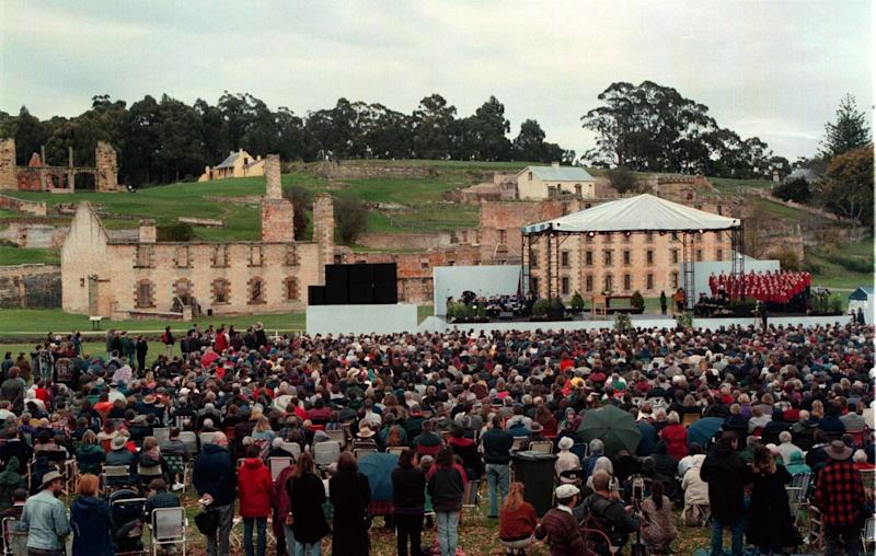 A memorial service is held May 19, 1996, at the Port Arthur historic site in Tasmania for the 35 victims of a mass shooting.