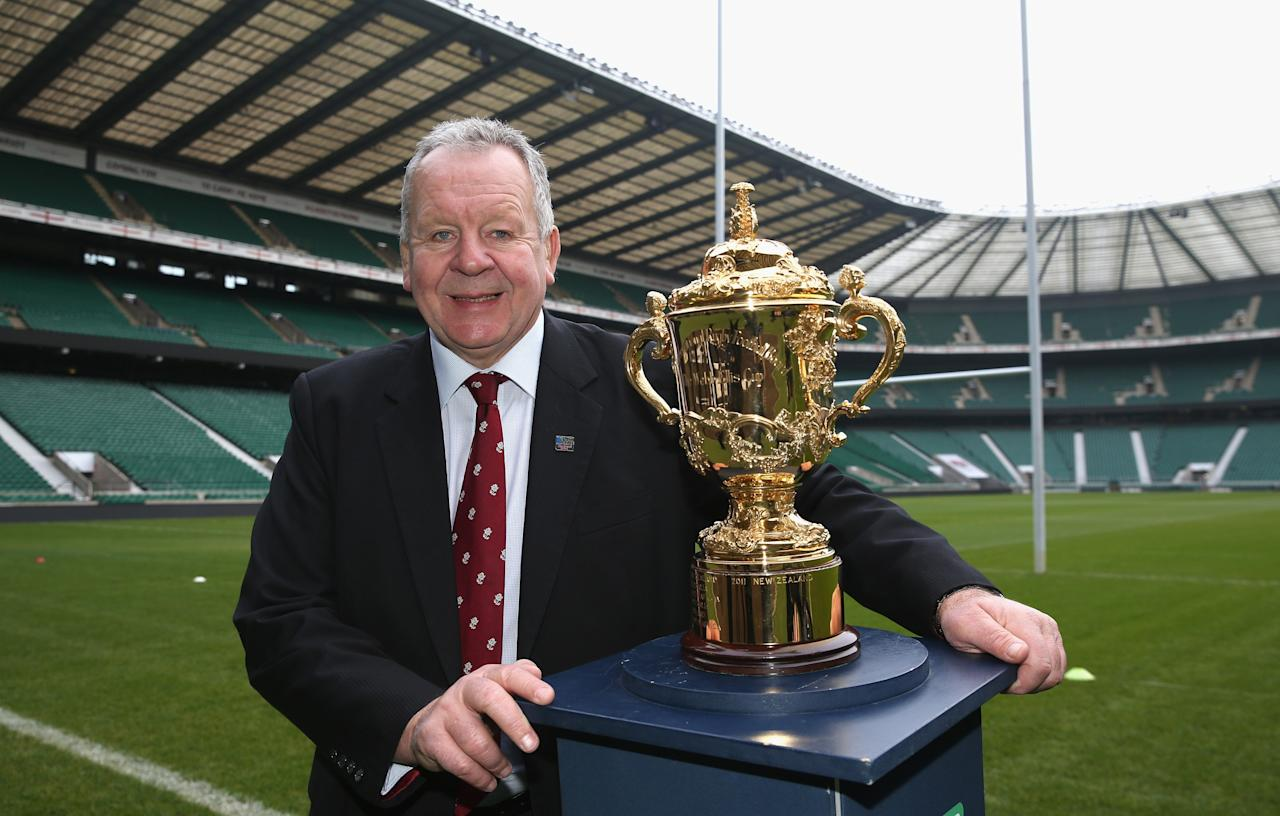 LONDON, ENGLAND - NOVEMBER 27: Bill Beaumont, the RFU Chairman, poses with the Webb Ellis Cup during the England 2015 Rugby World Cup Ticketing and Times launch on November 27, 2013 in London, England. (Photo by David Rogers/Getty Images for iRB)