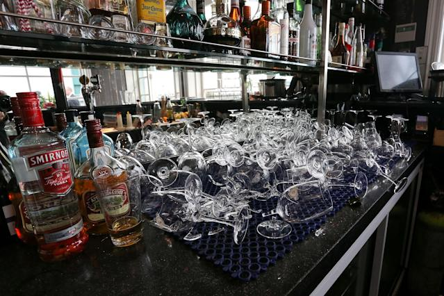 WELLINGTON, NEW ZEALAND - AUGUST 16: Broken glasses cover a section of the bar at Shed 5 restaurant after being damaged in a magnitude 6.2 earthquake on August 16, 2013 in Wellington, New Zealand. The quake struck Wellington at 2:31pm local time and was felt as far as Auckland on the north Island and Dunedin on the south. There have been reports of injuries but no fatalities. (Photo by Hagen Hopkins/Getty Images)