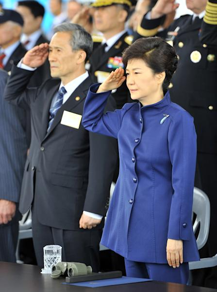 South Korean President Park Geun-hye, right, and Defense Minister Kim Kwan-jin salute during a ceremony marking the 65th anniversary of the founding of South Korea's Armed Forces at an air base in Seongnam, south of Seoul, on Tuesday, Oct. 1, 2013. (AP Photo/Jung Yeon-je, Pool)