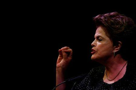 """FILE PHOTO: Former Brazilian president Dilma Rousseff attends the """"Neoliberalism, inequality, democracy under attack"""" conference in Lisbon"""