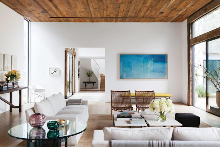 An airy Los Angeles living room painted in Benjamin Moore's Super White.