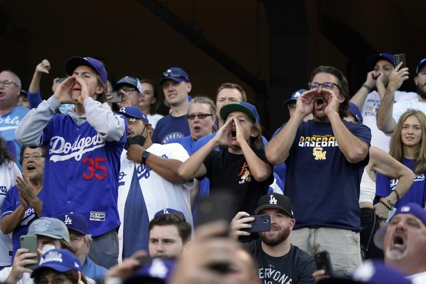 Fans boo as Houston Astros' Jose Altuve bats during the first inning of the team's baseball game against the Los Angeles Dodgers on Tuesday, Aug. 3, 2021, in Los Angeles. (AP Photo/Marcio Jose Sanchez)