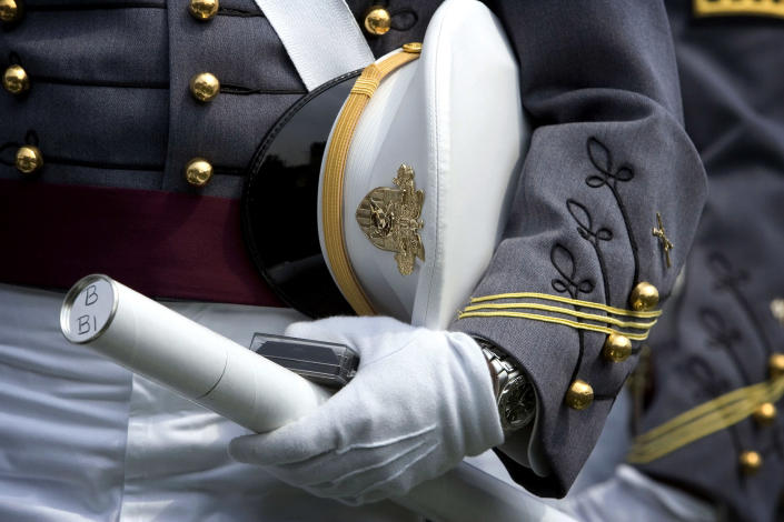 Image: A cadet holds his diploma at U.S. Military Academy Graduation at West Point in N.Y. in 2007. (Stephen Chernin / Getty Images file)