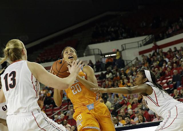 Tennessee center Isabelle Harrison (20) drives between Georgia forward Merritt Hempe (13) and Georgia guard Tiaria Griffin in the first half of an NCAA college basketball game Sunday, Jan. 5, 2014, in Athens, Ga. (AP Photo/John Bazemore)