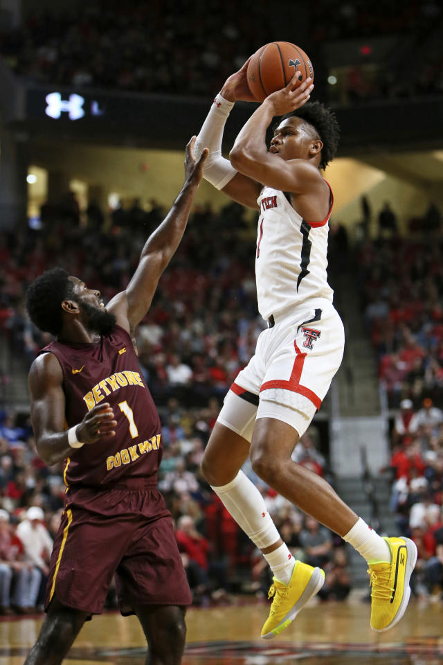 Texas Tech's Terrence Shannon Jr. (1) shoots the ball over Bethune-Cookman's Malik Maitland (1) during the first half of an NCAA college basketball game Saturday, Nov. 9, 2019, in Lubbock, Texas. (Sam Grenadier/Lubbock Avalanche-Journal via AP)/Lubbock Avalanche-Journal via AP)