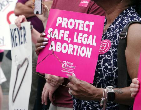 "FILE PHOTO: A pro-choice activist holds a sign in downtown Memphis during a ""Stop Abortion Bans Day of Action"" rally hosted by the Tennessee chapter of Planned Parenthood in Tennessee, U.S., May 21, 2019.  REUTERS/Karen Pulfer Focht"