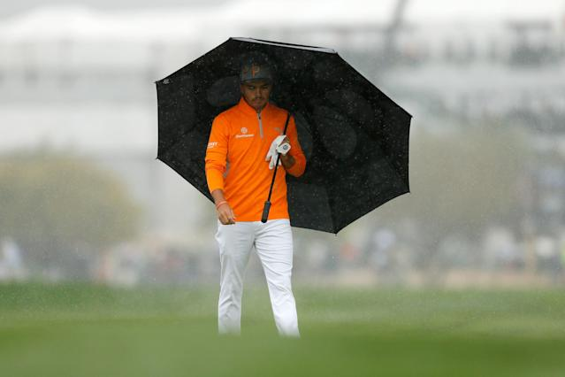 "<div class=""caption""> Fowler was looking for cover after his five-stroke lead turned into a one-stroke deficit on the back nine at TPC Scottsdale. </div> <cite class=""credit"">Michael Reaves/Getty Images</cite>"