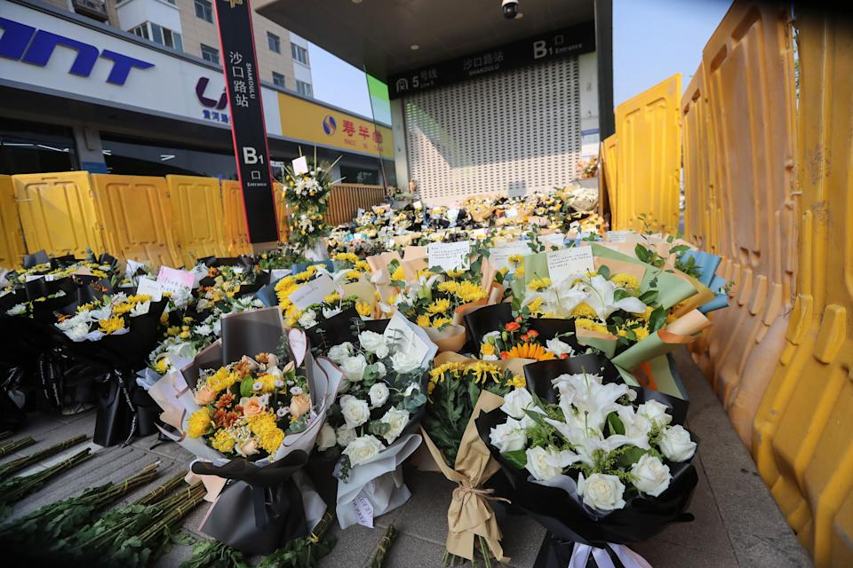 Flowers placed as tributes are seen in front of a subway station in memory of flood victims in Zhengzhou, China's central Henan province on July 27, 2021. China OUT  / AFP / STR