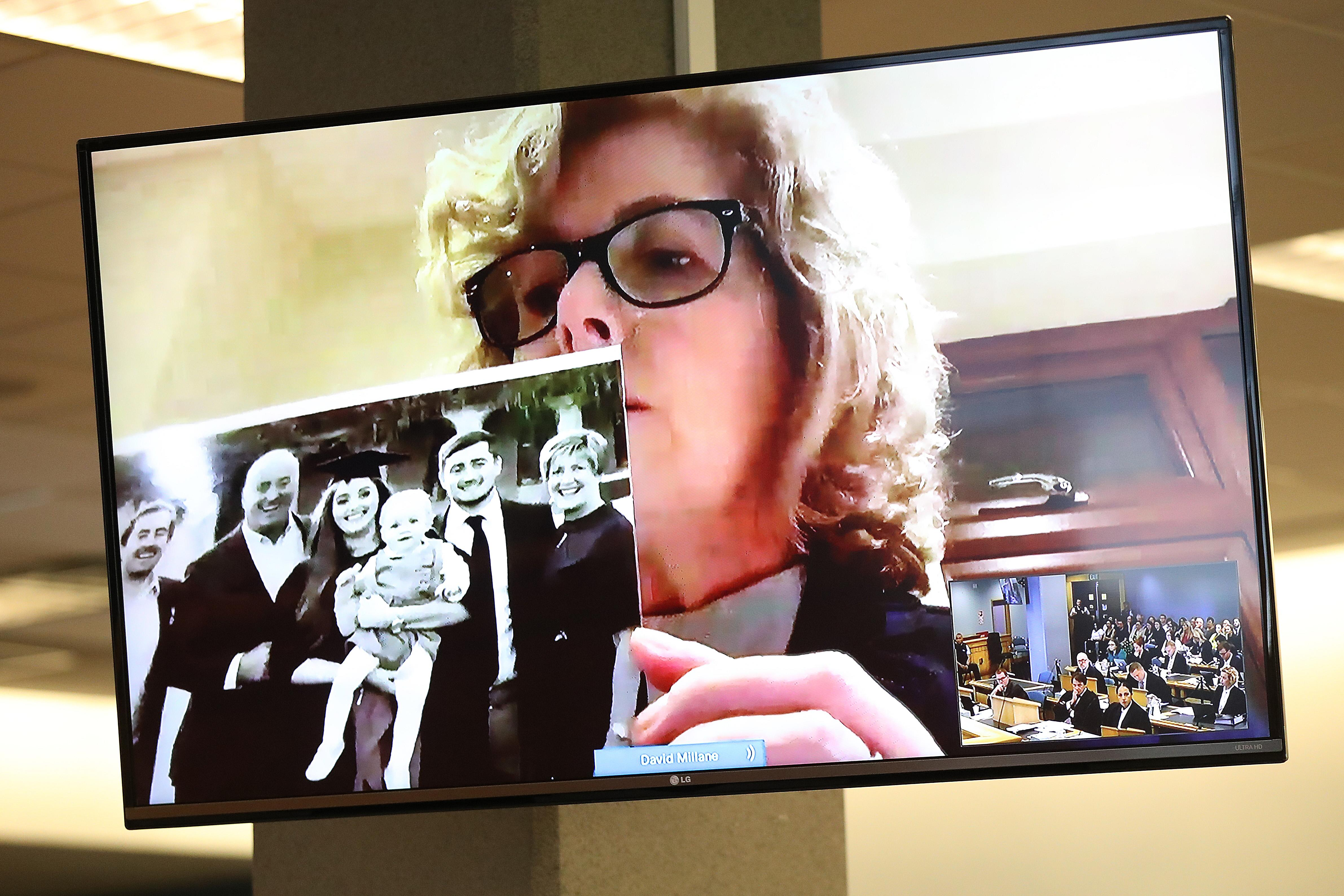 AUCKLAND, NEW ZEALAND - FEBRUARY 21: Gillian Millane holds a family photograph during her televised victim impact statement from her home in the UK on February 21, 2020 in Auckland, New Zealand. The 28-year-old man was found guilty of the murder of British backpacker Grace Millane, whose body was found in bush in West Auckland's Waitakere Ranges on 9 December 2018. Jurors at Auckland's High Court took about four hours to convict him in November 2019. A suppression order remains in place, prohibiting the publication of the accused's name or picture. (Photo by Greg Bowker/Getty Images)