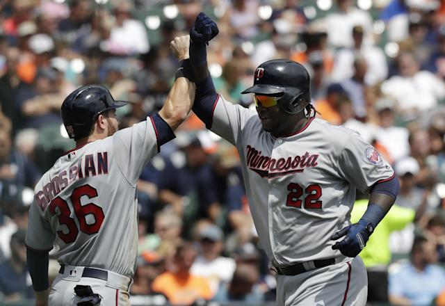 <p>Minnesota Twins designated hitter Miguel Sano (22) is greeted at home plate by Robbie Grossman after they both scored on Sano's two-run home run during the third inning of a baseball game against the Detroit Tigers, Sunday, Aug. 13, 2017, in Detroit. (AP Photo/Carlos Osorio) </p>