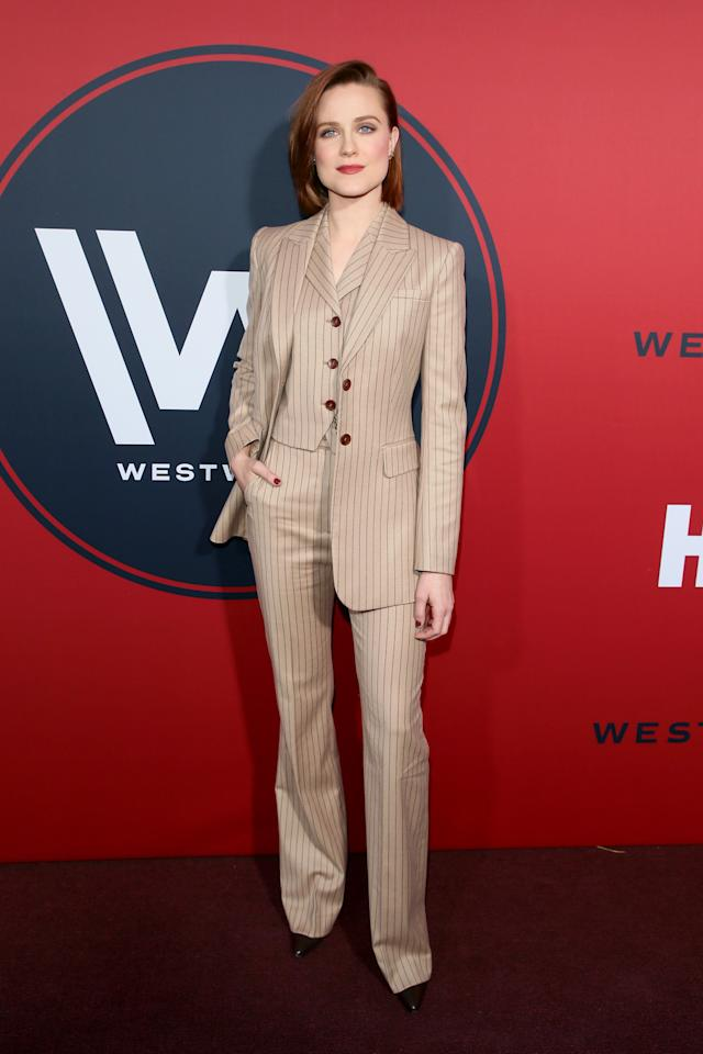 <p>To celebrate season two of Westworld, the star-studded cast took to the red carpet on April 16. And in true Evan Rachel Wood fashion, the actress donned one of her most covetable suits to date. The 30-year-old chose a pinstripe three-piece suit for the evening and accessorised the look with seriously embellished earrings and a copper-hued lip. <em>[Photo: Getty]</em> </p>