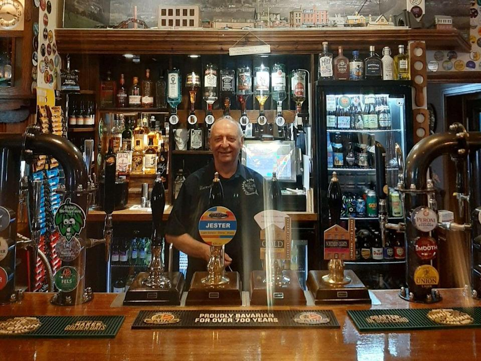 <p>Phil Wild from the Harewood Arms says it is a 'relief' to be back</p> (Zoe Tidman/The Independent)