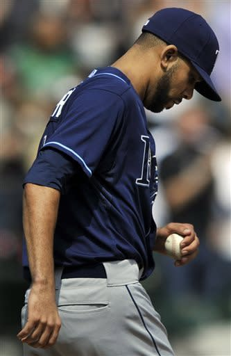 Tampa Bay Rays starting pitcher David Price (14) looks down after giving up a two-run home run to Chicago White Sox's Paul Konerko during the third inning of a baseball game in Chicago, Sunday, April 28, 2013. (AP Photo/Paul Beaty)
