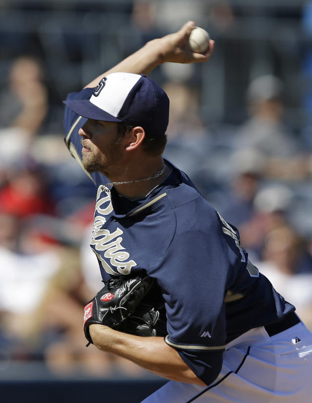 San Diego Padres starting pitcher Josh Johnson throws during the second inning of an exhibition spring training baseball game against the Cleveland Indians Saturday, March 8, 2014, in Peoria, Ariz. (AP Photo/Darron Cummings)