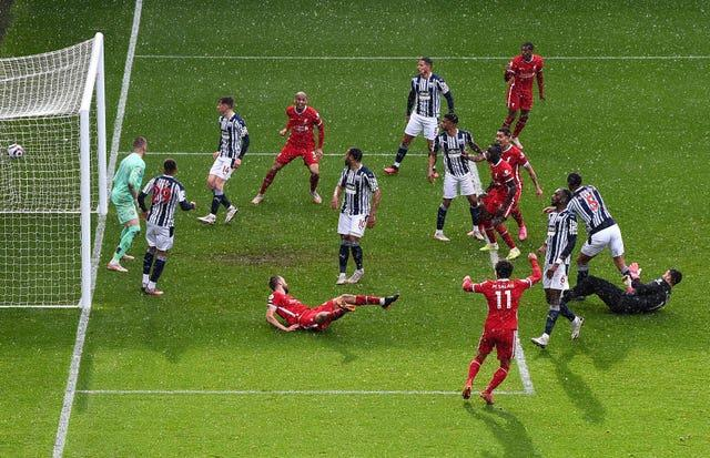 Liverpool goalkeeper Alisson, right, headed a stoppage-time winner at West Brom
