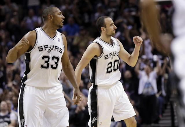 San Antonio Spurs' Boris Diaw (33), of France, and Manu Ginobili (20), of Argentina, celebrate during the first half of Game 1 of a Western Conference semifinal NBA basketball playoff series against the Portland Trail Blazers, Tuesday, May 6, 2014, in San Antonio. (AP Photo/Eric Gay)