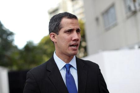 Venezuelan opposition leader and self-proclaimed interim president Juan Guaido speaks during an interview with Reuters in Caracas Venezuela