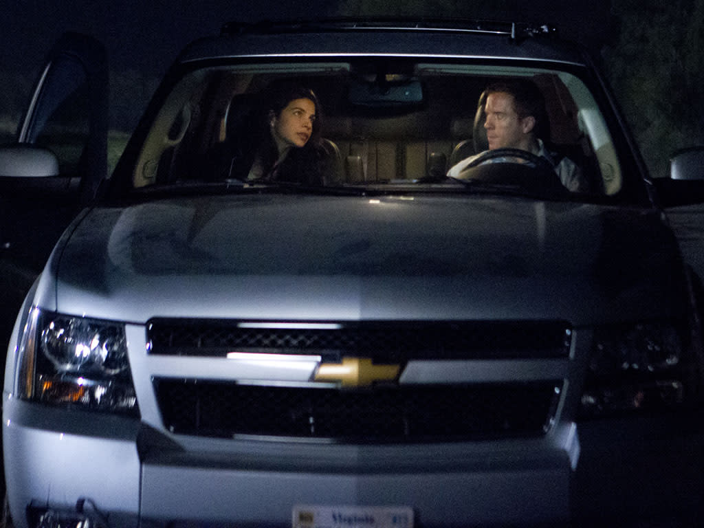 "Zuleikha Robinson as Roya Hammad and Damian Lewis as Nicholas ""Nick"" Brody in the ""Homeland"" Season 2 episode, ""I'll Fly Away."""